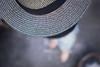 Put your hat on. And get up on a chair. (Gudzwi) Tags: 7dwf hat hut verdeckt versteckt hidden concealed blickvonoben viewfromabove masked strohhut strawhat grau grey gray muster pattern struktur texture textur kreisform circularity person people portrait selfportrait selbstporträt selfie unschärfe blur blurry unscharf diagonal sos smileonsaturday hatsandco hatandco icognito