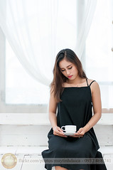Waiting with coffee (Hosting and Web Development) Tags: body beautiful black indoor nikon vietnam morning face female femininity woman white waiting thinking clothing arm asia dress hair hand cup coffee sit drink shoulder room young one portrait girl bottle deco