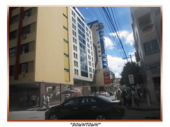 Down the Town (Guilherme Alex) Tags: city cityscape citylife citycenter cityview citizen mycity mylife myworld my downt downtown busy rushhour rush clouds sunnyday walking fast car wheels tree lines windowns sky blue white world teófilootoni minasgerais brazil samsung dv100 digitalcamera amateur shot art people urban urbaniza urbanization composition high up above street life living frame constrast picture green black buildings yeah daybyday monday sunny sun light