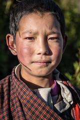 Portrait of a young boy in the village of Laya - Gasa District - Snowman Trek - Bhutan (PascalBo) Tags: nikon d500 asie asia southasia asiedusud drukyul drukgyalkhap bhutan bhoutan འབྲུག་ཡུལ། འབྲུག་རྒྱལ་ཁབ་ snowman trek trekking hike hiking lunana gasa himalaya himalayas jigmedorjinationalpark laya layap people portrait kid child enfant boy garçon outdoor outdoors pascalboegli 123faves