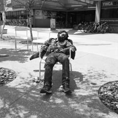 untitled (kaumpphoto) Tags: rolleiflex 120 tlf bw black white ilford hp5 street urban city sleep man tired shoes tennisshoes rocks pavement sidewalk ywca minneapolis nicollet nicolletmall nike bike untied