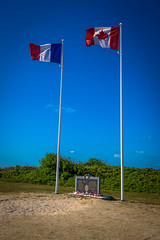 The Canadian flag is flying high and proud along the Normandy coast.