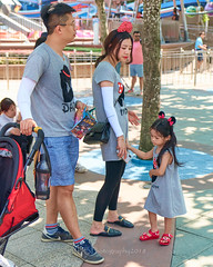 DisneyLand Street Scenes 31 (C & R Driver-Burgess) Tags: man woman boy girl umbrella shade sunny park pavement plaza tomorrowland pretty family couple minnie mouse ears spots patterned tamronaf2875mmf28ifldxrdispmacroa09