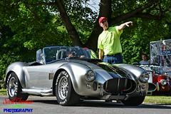 Shelby Cobra (Scottwdw) Tags: unitedstatesofamerica automobile cars ford liverpool longbranchpark newyork ssmc syracuseshelbymustangclub coba man people show classic pointing silver black stripes goodyear tires cpf circularpolarizerfilter sports