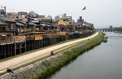 Riverside of Kyoto (Andreas Mezger - Photography) Tags: riverside asia japan kyoto river city cityscape bird people relax cloudy nikon photography