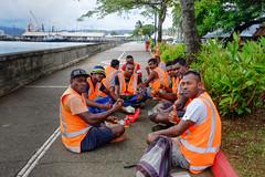 Suva - men at work (Marian Pollock) Tags: fiji suva island vitilevu men workers footpath seashore foreshore harbour garden sitting relaxing eating smiling wharf ship cranes street water ocean