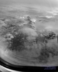 "Mt. Gannett, Mt. Goode & Mt. Grace Poking Thru the Clouds in ""Kodalith"" (AvgeekJoe) Tags: 737990 737990erwl alaskaair alaskaairlines bw blackwhite blackandwhite boeing737 boeing737900 boeing737990 boeing737990erwl d5300 dslr jetliners n275ak nikon nikond5300 aircraft airplane aviation jetliner plane aerial aerialphoto aerialphotograph aerialphotography"