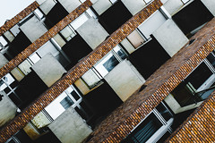 Steps of Confusion (Thomas Listl) Tags: thomaslistl color budapest hungary architecture graphical geometry geometric lines diagonal windows facade bricks abstract urban 100mm balcony
