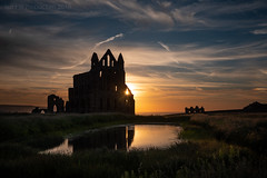 Whitby Abbey (ianrwmccracken) Tags: stone nikon orange d750 building window ruin benedictine england monument grass reflectionwater landscape abbey structure englishheritage religion religious blue historical silhouette yorkshire sunset cloud whitby history architecture nikkor2470mmf28 wall nikond750 monastery sky dracula bramstoker gothic low light pond pool cirrus