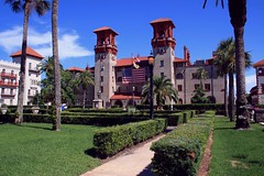 Lightner Museum / City Hall (PelicanPete) Tags: tower florida unitedstates usa saintaugustineflorida towersofstaugustine henryflagler architecture tall colorful beautiful intricate inspiring spanishinfluenced building roofline skyline alcazarbldg downtown staugustinecityhall fountain reflection tree grass sky road lightnermuseum flag cityscape july4th2018 independenceday palms entrance exterior park garden iconic epic