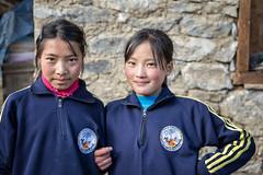 Young schoolgirls in the village of Laya - Gasa District - Snowman Trek - Bhutan (PascalBo) Tags: nikon d500 asie asia southasia asiedusud drukyul drukgyalkhap bhutan bhoutan འབྲུག་ཡུལ། འབྲུག་རྒྱལ་ཁབ་ snowman trek trekking hike hiking lunana gasa himalaya himalayas jigmedorjinationalpark laya layap indigenous people girl fille child enfant kid smile sourire portrait outdoor outdoors pascalboegli