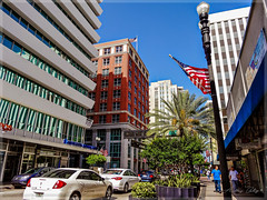 Walking the streets of Downtown Miami. (Aglez the city guy ☺) Tags: downtownmiami walking walkingaround architecture afternoon street flags miamicity miamifl urbanexploration unitedstates outdoors trees building