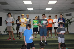 BOSH Volunteers teaching Here I Am Lord