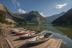 Boats on the bank (emvee_de) Tags: landscape landscapes mountain mountainrange alps austria tyrol nature lake mountainlake boats idyllic