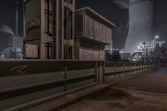 Walsum, Lift bridge (Markus Lehr) Tags: industriallandscape bridge liftbridge puddle streetlights coolingtower manmadelandscape urbanspace urban night longexposure langzeitbelichtung nightshots nightphotography light mood atmosphere nopeople peoplelessness contemporaryphotography duisburg germany markuslehr