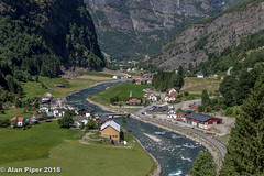Approaching Flam on Flamsbana (PapaPiper) Tags: flamrailway flamsbana norway railway train river mountain mountainview riverscape village