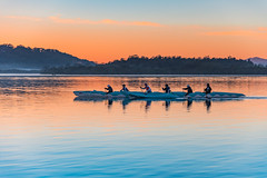 Early Morning Central Coast Paddlers on the bay (Merrillie) Tags: daybreak woywoy oceanpearl landscape nature australia foreshore newsouthwales water earlymorning nsw brisbanewater centralcoastoutriggercanoeclub outrigging canoeists morning dawn coastal paddlers sky waterscape sunrise centralcoast bay outdoors