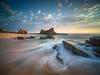 Swooshery (lloydlane) Tags: portugal sunset rocks long exposure dramatic praia da samoqueira wave sky clouds swooshery swoosh