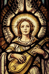 Ancient Roman iconography in a modern cathedral (sniggie) Tags: angel churchwindow music wings stainedglass church cathedral stvincentdepaulchurch sistersofcharityofnazareth catholic portrait lute angelwings halo robe wreath crown
