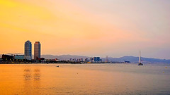 Another Barcelona Sunset (Fnikos) Tags: sea water bay sky skyline cloud sunset sun city architecture tower waterfront boat sailboat tree nature people outdoor