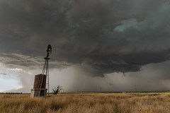Oklahoma Panhandle Storm (mesocyclone70) Tags: thunderstorm windmill storm stormchase lightning thunder supercell texas landscape prairie grass sky