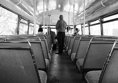 Anymore Fares Please ? (tcees) Tags: towerhill london ec3 man woman people x100 fujifilm finepix streetphotography street bw mono monochrome blackandwhite urban seats bus routemaster conductor window heritage 15 poles londontransport publictransport vintage tourists routemasterbus roof ceiling lights interior