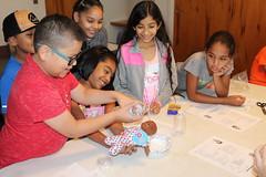 BOSH campers re-enact their baptism