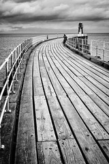 Whitby Pier (Rich Presswood) Tags: fuji fujixpro2 silverefexpro2 adobelightroom monochrome bw blackandwhite mono manualfocus 7artisans 25mmf18 35mmf12 eastcoast whitby pier