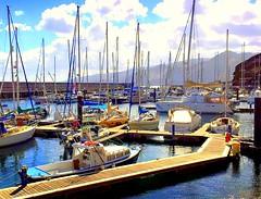 Madeira, Portugal. Funchal Marina (dimaruss34) Tags: newyork brooklyn dmitriyfomenko image sky clouds portugal madeira svetlanafomenko funchal marina yachts boats catwalk mountains water