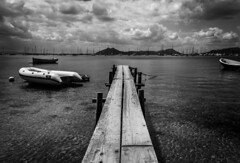 Pollenca, Mallorca (alastair.woodward) Tags: blackandwhite light dark black white mono water sea boats sky clouds jetty monochrome canon 5diii pollenca