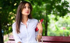 DSC06445 (toivo_xiv) Tags: kyiv ukraine glasses pretty purse red redlips redpurse girl clock park green bench beauty