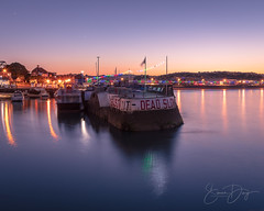 Paignton Harbour at Sunset (simondayuk) Tags: paignton harbour devon seascape reflection reflections water coast coastal sunset dusk streetlights afterdark nikon d500 nikond500 boat boats bay torbay flag slow