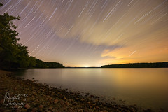 Star Trail over a Peaceful Bay (Michael Allen Siebold (Getty Images Contributor)) Tags: awe barkleylake beach beauty beautyinnature cloudysky kentucky landbetweenthelakes multipleexposure nopeople outdoors outerspace photography scenicsnature stacking starspace startrail startrails tranquilscene tranquility watersedge woodland blurredmotion branch clouds concentric cravensbay dark deamaticsky forest idyllic illuminated landscape lightnaturalphenomenon lighteffect long longexposure majestic motion naturalphenomenon nature night reflection sand shore sky starfield time tree trees water wideangle woods