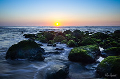 Capbreton sunset on rocks (Marc Heurtaut) Tags: capbreton colors longexposure water waterfront atlanticocean beach clouds composition dusk france landscape ricohgr sunlight sunset wideangle nouvelleaquitaine fr