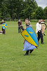 Historia Normannis Meadows June 2018-768 (Philip Gillespie) Tags: historia normannis central scotland sparring fighting shields swords axes spears park grass canon 5dsr men man women woman kids boys girls arms feet hands faces heads legs shins running outdoor tabards chain mail chainmail helmets hats glasses sun clouds sky teams solo dead act acting colour color blue green red yellow orange white black hair practice open tutorial defending attacking volunteer amateur kneeling fallen down jumping pretty athletic activity hit punch