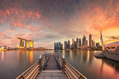 Golden Waterfront (Scintt) Tags: singapore mbs marina bay water clarity filter golden sunset sun sky clouds dramatic travel tourist attraction exploration movement motion skyline cityscape city urban modern structures architecture buildings offices shenton way cbd scintillation scintt jonchiangphotography hall iconic surreal epic wideangle nikon 1424 haidafilter neutraldensity still calm glow light tones rafflesplace nature pond pool pink dusk twilight waterfront bridge sands panorama stitched pier jetty jubilee burn orange yellow reservoir longexposure slowshutter