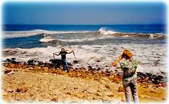 Montauk Point Beach c. 1990 (Chris C. Crowley) Tags: montaukpointbeachc1990 beach montauknewyork longisland seashore coast coastal rocks sand ocean atlanticocean waves seaweed people man woman tourists