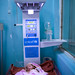 A pre-term baby is kept warm beneath an infant radiant warmer