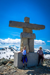 Lori and Tracey and Inukshuk on Whistler mountain
