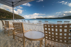 Coki Beach ready for a busy day (tquist24) Tags: caribbean caribbeansea cokibeach nikon nikond5300 stthomas usvirginislands virginislands bay beach chair chairs clouds geotagged hills island morning ocean sand sea seascape sky table tropical water