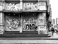 Corner Building (Demmer S) Tags: street corner building streetphotography people pedestrian peoplewatching shootthestreet streetlife streetshots documentary citylife person urban city outside urbanphotography streetscene urbanexploration outdoors facade wallscape architecture architectural urbandetails pavement steps curb doors windows signs signage words text graffiti scribbles visual exterior surface marks writing scribbled scrawls scribbling scrawled markings doodles streetart graffitiart urbanart wallart streetartistry doodle drawing wall buildingart graffitiphotography nycgraffiti canalstreet chinatown lowermanhattan manhattan ny newyork nyc newyorkcity bw monochrome blackandwhite sign graffitiphotographer