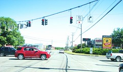 A LOOK NORTH ON ULSTER AVE IN JULY 2018 (richie 59) Tags: ulstercountyny ulstercounty newyorkstate newyork townofulsterny townofulster unitedstates weekend route9w rt9w trees traffic automobiles autos motorvehicles vehicles 9w usroute9w ushighway saturday roadsigns intersection ulsterny ulster cars richie59 america outside summer trafficlights grass signs us9w 2018 july72018 july2018 2010s hudsonvalley midhudsonvalley midhudson ny nys nystate usa us 4lane fourlane 4lanehighway fourlanehighway highway road suv gmc poles wires stores shopping
