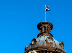 South Carolina State Capitol in Color (Shawn Blanchard) Tags: architecture design downtown nikon d7100 dome building color blue flag brown window historic columbia south carolina sc sky fly flight plane air airplane contrail white circle america