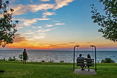 Better Than TV (jmhutnik) Tags: lakeerie water waves sunset swing couple sky willowick clouds scenery park grass trees