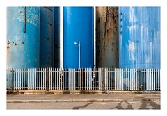 Silos (Number Johnny 5) Tags: lamp lines crusty d750 2470mm decay industrial space topographics light ordinary documentary blue urban imanoot banal tamron silos nikon rusty mundane angles johnpettigrew fence documenting barrier