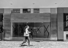 Texting (dlsmith) Tags: black white bw byn monochrome monochromatic girl street urban leeds stphotographia england texting yorkshire candid