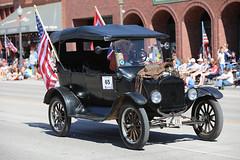 Saddled Model T (wyojones) Tags: wyoming cody 2018 codystampedeparade auto car automobile modelt ford parade flag usflag starspangledbanner oldglory drive cowboy saddle hood