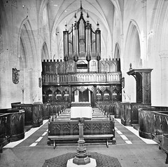 """NOT a """"Gothic revival/restoration stone church, square castellated tower with four corner spires"""", but Down Cathedral (National Library of Ireland on The Commons) Tags: thestereopairsphotographcollection lawrencecollection stereographicnegatives jamessimonton frederickhollandmares johnfortunelawrence williammervynlawrence nationallibraryofireland gothic church interior ambo lectern seats stalls organ downcathedral downpatrick stpatrickscathedral pipeorgan cathedralchurchoftheholytrinity pulpitum pipes locationidentified probablycataloguecorrection possiblecataloguecorrection"""