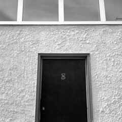 8 (kaumpphoto) Tags: rolleiflex 120 tlr 8 door wall stucco window street urban city bw black white lock minneapolis