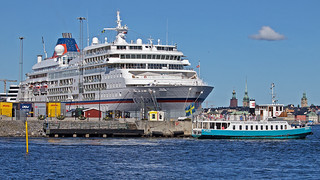 The cruise ship Europa in Stockholm, the commuter boat Emelie passing by